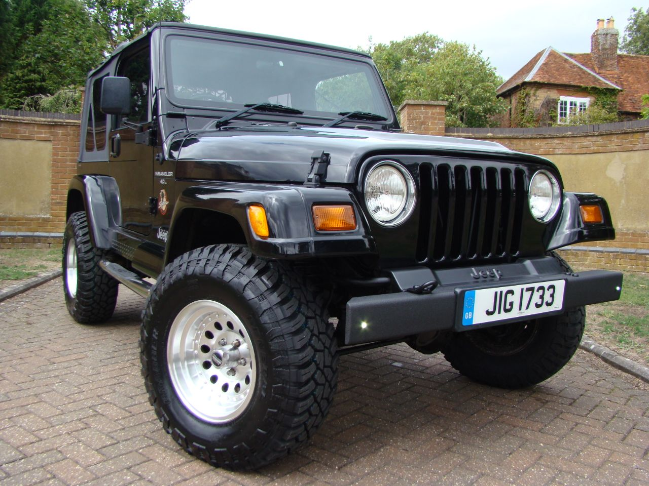 Jeep Wrangler 4.0 Sahara Auto Soft Top Estate Petrol Black at Claridges Cars Leighton Buzzard