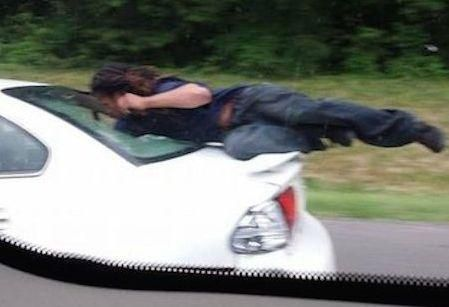 Car-surfer shocks US highway drivers