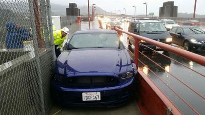 Ford Mustang wedged on Golden Gate Bridge